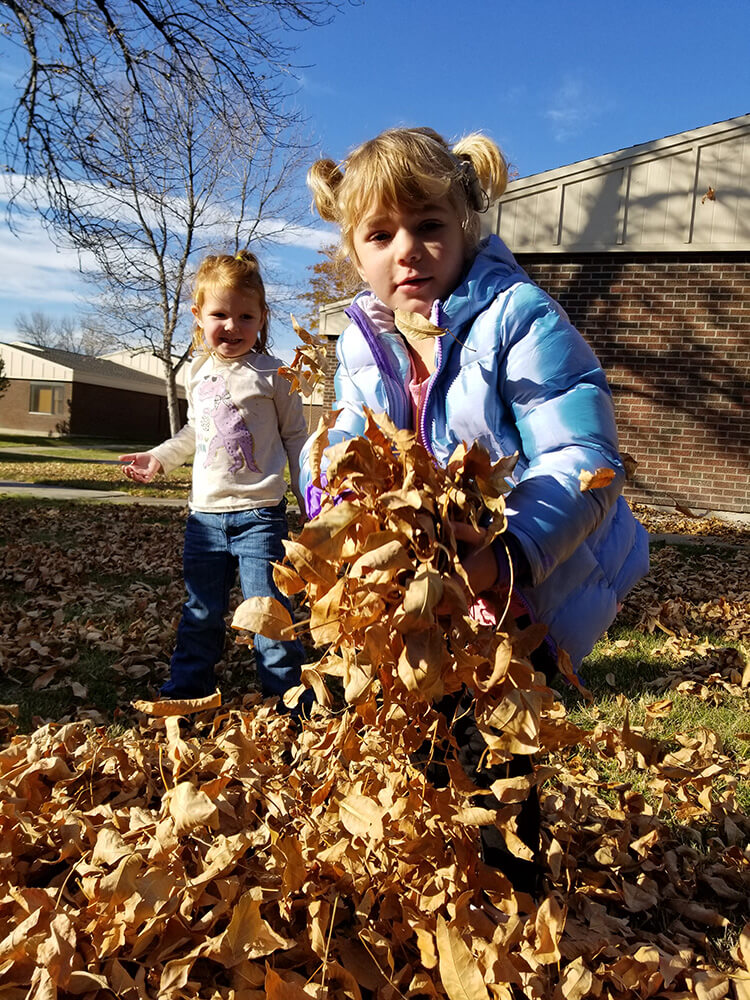 kids playing in leafs