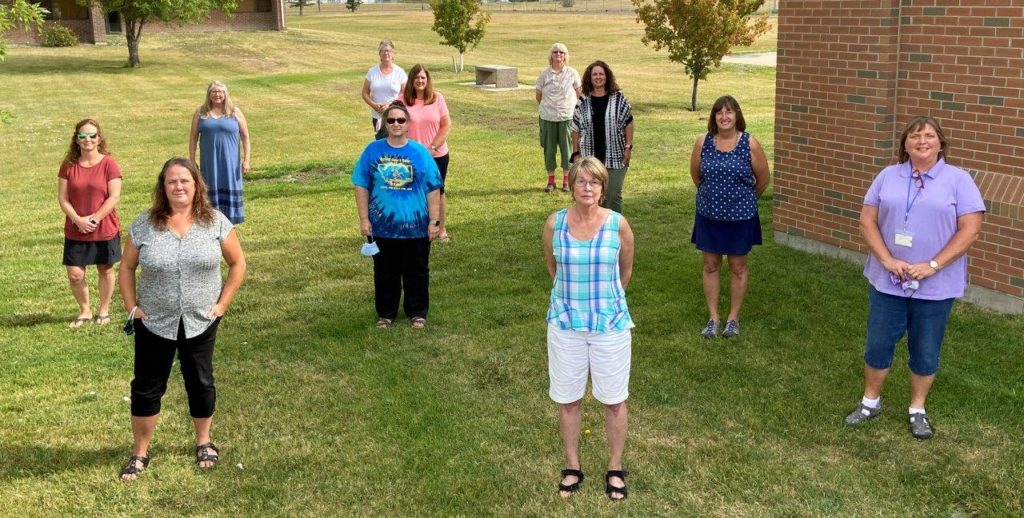 A group picture of the MSDB Outreach staff on the campus grass.